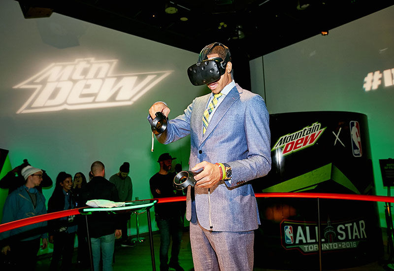 DEW athlete C.J. McCollum tests out the Tilt Brush app by Google at the Mountain Dew Presents Court Vision Interactive Virtual Realty Art Experience during NBA All-Star 2016.