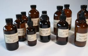 Numerous brown bottles of syrups, juices and flavors HBO The Nevers
