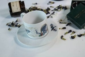 victorian tea set with scattered tea leaves HBO The Nevers