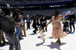 clear-day-of-families-2021_11 a family ready to hug metlife stadium