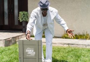 Amazon film launch 2021_Drone_Wesley Snipes opens gift box