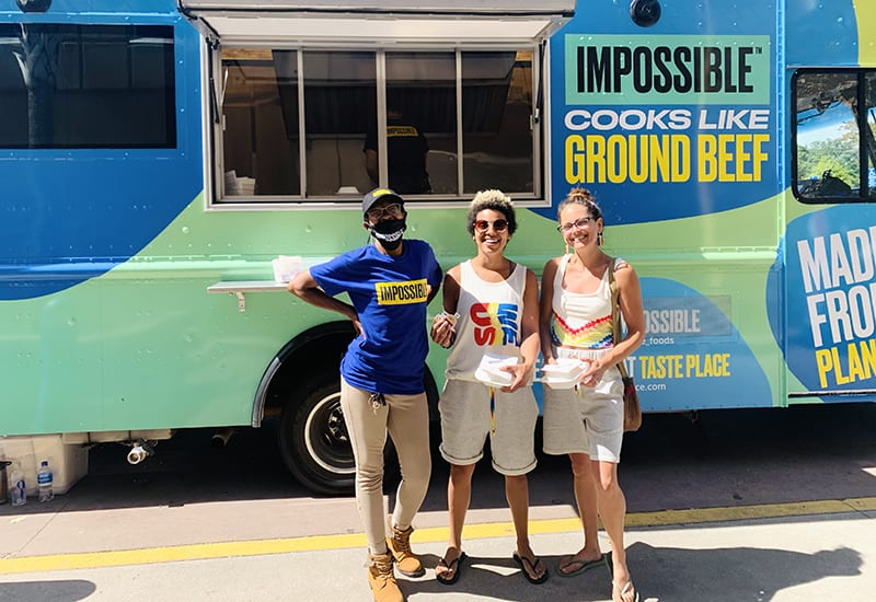 mobile tour 2021 three women in front of food truck