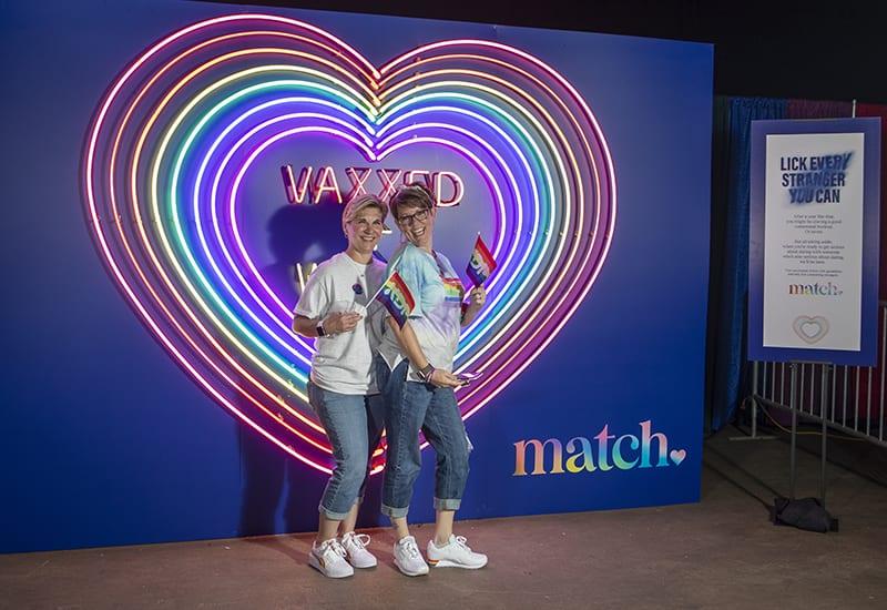 Match Pride 2021_two women rainbow heart photo op